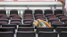Workers install new seats as they prepare to re-open the Scotiabank Saddledome in Calgary. (Chris Bolin/The Globe and Mail)