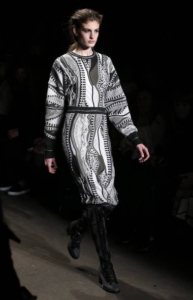 Rag & Bone's irregular knits stood out thanks to their Cosby-sweater-gone-cool look. The motif was subtle as a crew neck in muted browns but best as a sweater dress in black and white. (Jason DeCrow/AP)
