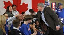 Prime Minister Stephen Harper greets supporters during an election campaign rally in Guelph on April 4, 2011. (CHRIS WATTIE/Chris Wattie/Reuters)
