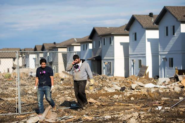 Destroyed houses in the Timberlea neighbourhood are seen as thousands of evacuees who fled a massive wildfire began to trickle back to their homes in Fort McMurray on June 1, 2016.