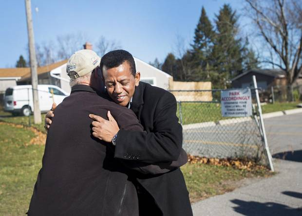 Kenzu Abdella, right, President of the Kawartha Muslim Religious Association hugs Larry Forsey, left, after Forsey gave a donation at the mosque Masjid Al-Salaam on Nov. 16.