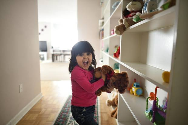 Sava Al Rasoul, 3, beside her wall of stuffed toys near the front door of her family's apartment.
