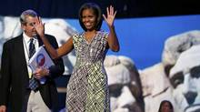 With an image of the Mount Rushmore National Memorial serving as a backdrop, U.S. first lady Michelle Obama tours the stage and podium a day before her speech to the Democratic National Convention in Charlotte, N.C, Sept. 3, 2012. (Jim Young/Reuters)