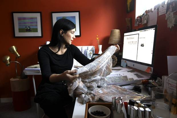 In Edmonton, Jana Pruden researches newspaper articles printed on a scarf from China.