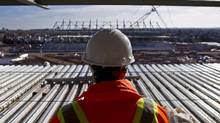 File photo of a construction worker overlooking the site of the Pan Am soccer stadium in Hamilton, Nov. 14, 2013. (Asron Lynett/The Canadian Press)