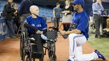 Toronto Blue Jays J.P. Arencibia chats with cancer patient Jessica Dunn before opening day baseball action in Toronto (Chris Young/THE CANADIAN PRESS)