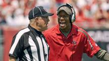Tampa Bay Buccaneers head coach Raheem Morris yells at line judge Ron Phares in the first half of their NFL football game against the Dallas Cowboys at Raymond James Stadium in Tampa, Florida September 13, 2009. (PIERRE DUCHARME)