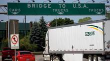 Traffic makes its way to Ambassador Bridge that connects Canada to the United States in Windsor. Ont. (Mark Spowart/THE CANADIAN PRESS)