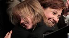 British Columbia Liberal Leadership candidate Christy Clark hugs her son Hamish, 9, after being elected as the party's new leader in Vancouver, B.C., on Saturday February 26, 2011. Clark replaces outgoing Premier Gordon Campbell. (Darryl Dyck/The Canadian Press/Darryl Dyck/The Canadian Press)