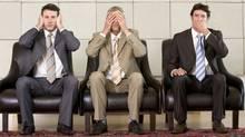 Three businessmen (claudiobaba/Getty Images/iStockphoto)