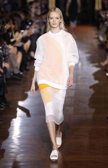 For spring, Stella McCartney reduced her collection to a sleek series of ellipses and squares. Layers of organza gave them a hazier outline. (Reuters)