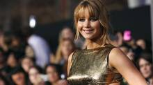 Jennifer Lawrence at the premiere of The Hunger Games in Los Angeles, March 12, 2012. (MARIO ANZUONI/REUTERS)
