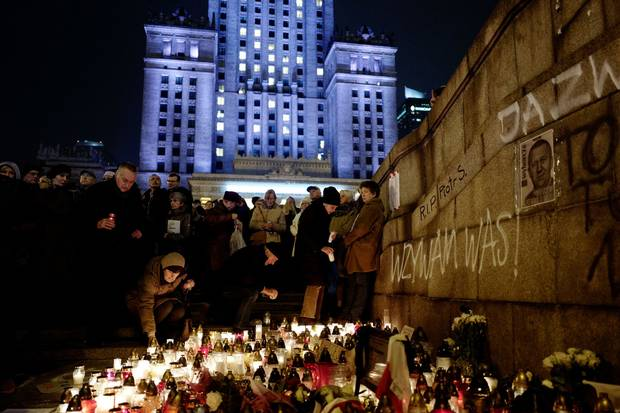 Nov. 6, 2017: People gather and lay candles in the place where Piotr Szczesny killed himself. They hold papers reading 'I, the everyman.'