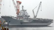 A vessel reported to be the Ukrainian-made aircraft carrier Varyag, which China bought in the 1990s, is seen at a port in Dalian, Liaoning province in this April 17, 2011 file photo. The Indian navy, worried about what it sees as Chinese encirclement at sea, is deepening defence ties with long-term partner Vietnam, and cautiously stepping up its presence in the South China Sea, whose mineral and gas resources are claimed by six countries, including China. (Jacky Chen/Reuters/Jacky Chen/Reuters)