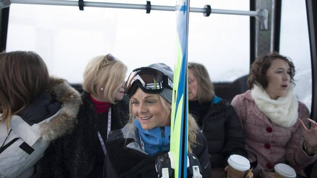 Austrian pro skier and filmmaker Sandra Lahnsteiner, middle, on the Whistler Village Gondola with other attendees of the Women on Top breakfast