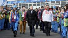 In this Wednesday, Feb. 5, 2014 file photo, Russian President Vladimir Putin, centre, visits the Olympic Athletes Village in Coastal Cluster ahead of the Sochi 2014 Winter Olympics with Olympic Village Mayor Elena Isinbaeva, left, and Russian Minister of Sport, Tourism and Youth policy Vitaly Mutko in Sochi, Russia. (Pascal Le Segretain/AP)