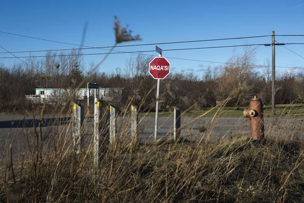 A stop sign in Paqtnkek Mi'kmaw Nation.