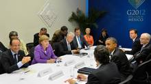 (Left row, front to back) French President Francois Hollande, German Chancellor Angela Merkel, Italian Prime Minister Mario Monti, Spanish Prime Minister Mariano Rajoy, (right row, back to front) British Prime Minister David Cameron, European Council President Herman Van Rompuy, U.S. President Barack Obama and European Commission President Jose-Manuel Barroso meet Tuesday on the second day of the G20 Summit in Los Cabos, Mexico. (HANDOUT/REUTERS)