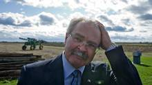 Agriculture Minister Gerry Ritz leaves an Ottawa-area farm after announcing legislation to eliminate the Canadian Wheat Board on Oct. 18, 2011. (Sean Kilpatrick/THE CANADIAN PRESS)