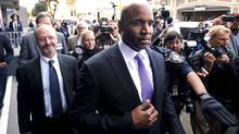 Former baseball player Barry Bonds leaves federal court Wednesday, April 13, 2011, in San Francisco, after being found guilty of one count of obstruction of justice. The jury failed to reach a verdict on three other counts that the home run king lied to a grand jury when he denied knowingly using steroids and human growth hormone. (Noah Berger)