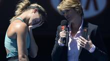 Eugenie Bouchard of Canada reacts to a question from with television reporter Sam Smith during a post match interview following her quarterfinal win over Ana Ivanovic of Serbia at the Australian Open tennis championship in Melbourne, Australia, Tuesday, Jan. 21, 2014. (Andrew Brownbill/AP)