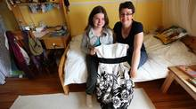 Eleven-year-old Emma Helm and her mother Corey Helm pose with the dress Emma will wear to grade six graduation and after-party. (Deborah Baic/Deborah Baic/The Globe and Mail)