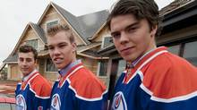 Jordan Eberle, left, Taylor Hall, centre, and Magnus Paajarvi pose in front of a show home that will be won by a lucky lottery winner, with the proceeds going to the Edmonton Oilers Community Foundation charity, after an Edmonton Oilers press conference on Wednesday, September 8, 2010. (John Ulan/THE CANADIAN PRESS)
