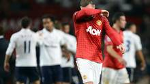 Manchester United's Wayne Rooney wipes his face as he walks off the pitch following their English Premier League match against Tottenham Hotspur at Old Trafford in Manchester, northern England, September 29, 2012. (NIGEL RODDIS/REUTERS)