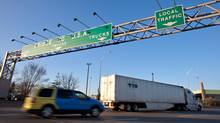 Traffic bound for Detroit approaches Windsor's Ambassador Bridge (GEOFF ROBINS/Geoff Robins for The Globe and Mail)