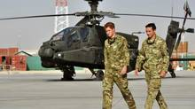 Britain's Prince Harry is shown the Apache helicopter flight line at Camp Bastion, Afghanistan September 7, 2012. (John Stillwell/REUTERS)