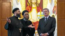 In this file photo, Stephen Harper tours a Coptic Christian Church in Mississauga, Ont., with Fathers Pishoy Wasfy, left, and Angelos Saad on January 13, 2011. (Darren Calabrese/The Canadian Press/Mike Cassese/Reuters)