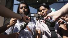 Darshika Selvasivam (left) with the Tamil Refugee coordinating committee and Katpana Nagendra (right) with the BC Canada representative of the Transnational Government of Tamil Eelam outside the immigration and refugee board in Vancouver August 17, 2010 after the IRB made a ruling on the publication ban. (John Lehmann/The Globe and Mail/John Lehmann/The Globe and Mail)