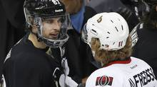 Pittsburgh Penguins' Sidney Crosby (L) shakes hands with Ottawa Senators' Daniel Alfredsson after the Penguins eliminated the Seantors in their NHL Eastern Conference semi-final hockey series in Pittsburgh, Pennsylvania May 24, 2013. (Reuters)
