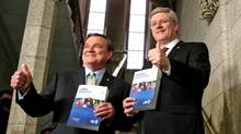 Prime Minister Stephen Harper and Finance Minister Jim Flaherty give a thumbs up as they enter the House of Commons to deliver the federal budget on March 29, 2012. (Dave Chan/Dave Chan for The Globe and Mail)