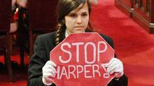 Page Brigette DePape stages a protest in the middle of the Senate floor during the Speech from the Throne on June 3, 2011. (Sean Kilpatrick/THE CANADIAN PRESS)