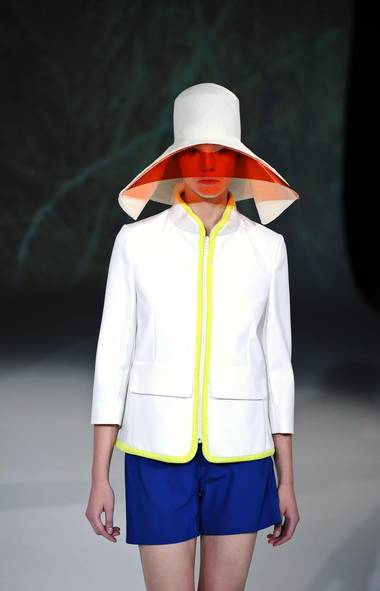 "Hussein Chalayan keeps moving away from the highly conceptual studies that would define his collections as beautifully… strange. For spring, he used a ""Seize the Day"" theme to bring dimension to sportswear (one net fabric was literally 3-D). Put in your order for a straw hat-visor hybrid ASAP. (Zacharie Scheurer/AP)"