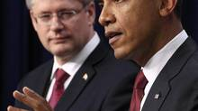 U.S. President Barack Obama, right, and Prime Minister Stephen Harper hold a joint news conference in Washington Feb. 4, 2011. (JIM YOUNG/REUTERS)