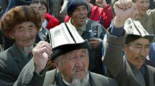 Many of the protestors who disrupted a mining auction in Bishkek on Monday were wearing traditional Kyrgyz felt hats, like these in a 2005 file photo. (IVAN SEKRETAREV/AP)