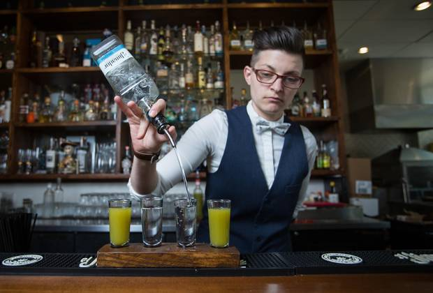 Bar manager Vanessa Coupar pours tequila with a verdita chaser at El Santo in New Westminster, British Columbia.