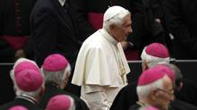 Pope Benedict XVI leaves at the end of a concert by The Leipzig Gewandhaus Orchestra, on the occasion of Pontiff's 85th birthday celebrations, in Paul VI hall at the Vatican in this April 20, 2012 file photo. (Tony Gentile/Reuters)