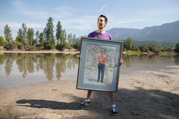 Aaron Leon Williams holds a portrait of Splatsin Elder