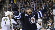 Winnipeg Jets Andrew Ladd celebrates his goal against the Dallas Stars during the second period of their NHL hockey game in Winnipeg March 14, 2012. (FRED GREENSLADE/REUTERS)