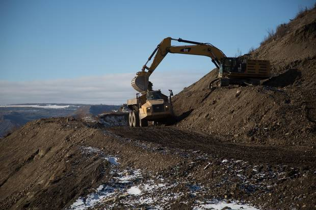 Construction equipment on the north bank of the Site C dam in March, 2017.