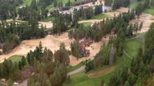 Water and debris surround homes at the edge of a golf course in Fairmont, B.C. (Emergency Info BC)