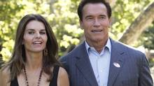 California Governor Arnold Schwarzenegger holds hands with his wife Maria Shriver as he walks to address the media after voting in the midterm elections at the Crestwood Hills Recreation Center in Los Angeles, California in this November 7, 2006 file photo. (Reuters)