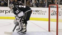 Los Angeles Kings goalie Jonathan Quick reacts after the New Jersey Devils scored their third goal in the third period during Game 4 of the Stanley Cup finals, Wednesday, June 6, 2012, in Los Angeles. The Devils won the game 3-1. (Julie Jacobson/AP)