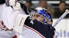 Columbus Blue Jackets goalie Curtis Sanford stops a shot during the second period of an NHL hockey game against the Los Angeles Kings, Wednesday, Feb. 1, 2012, in Los Angeles. (AP Photo/Mark J. Terrill) (Mark J. Terrill/AP)