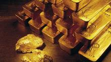 In this undated handout photo from Newmont Mining Corporation, gold nuggets and bars are shown. (Associated Press/Associated Press)