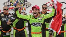 James Hinchcliffe celebrates his IndyCar victory in Newton, Iowa on June 23. (Justin Hayworth/AP)