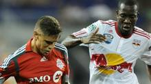 Adrian Cann (L) of Toronto FC and Salou Ibrahim (R) of the New York Red Bulls during game August 11, 2010 at Red Bull Arena in Harrison, New Jersey. Red Bulls won, 1-0. Getty Images/Stan Honda (STAN HONDA)